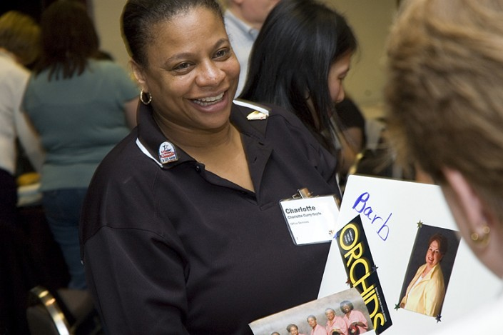 Photograph of volunteer at corporate event