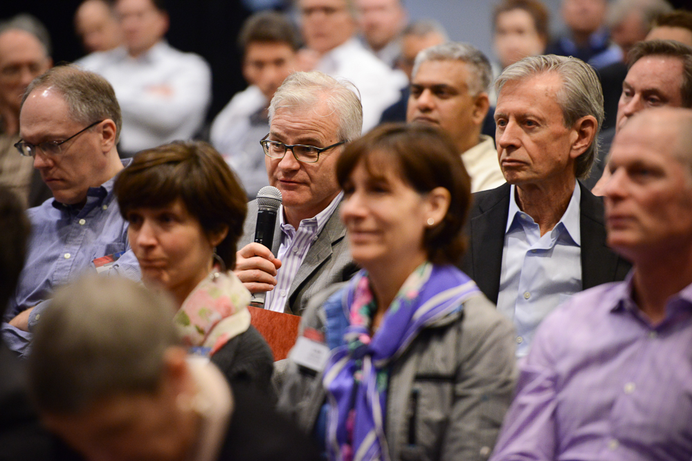 Businessman asking question at conference in Chicago