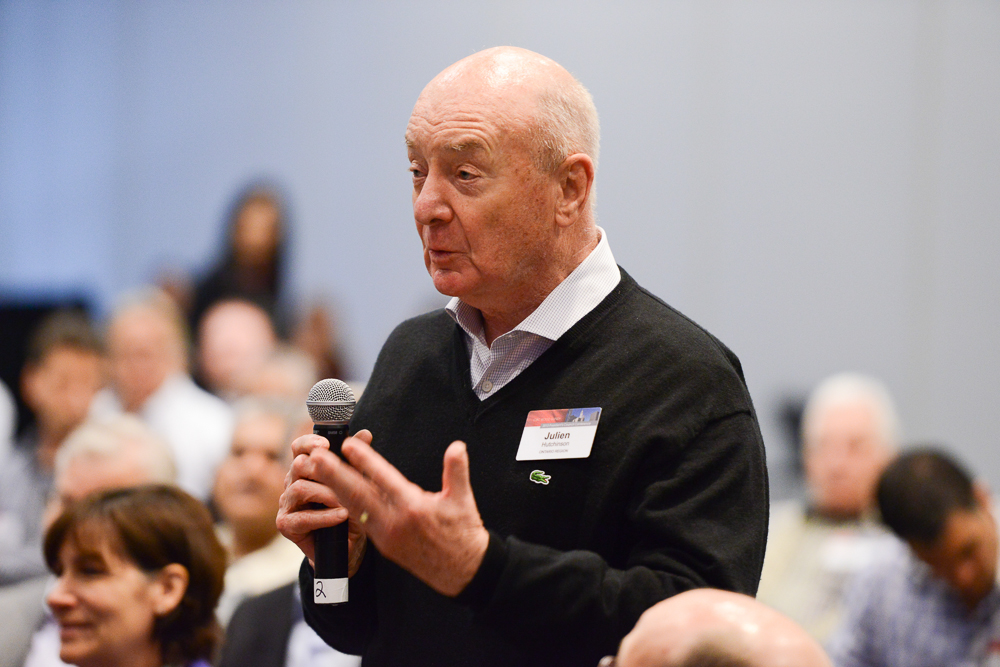 Man asking question at Chicago event by G Thomas Ward Photography