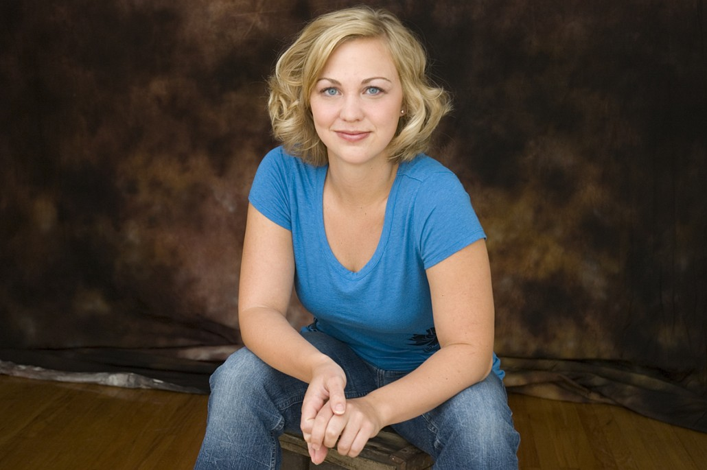 Actress in blue shirt head shot